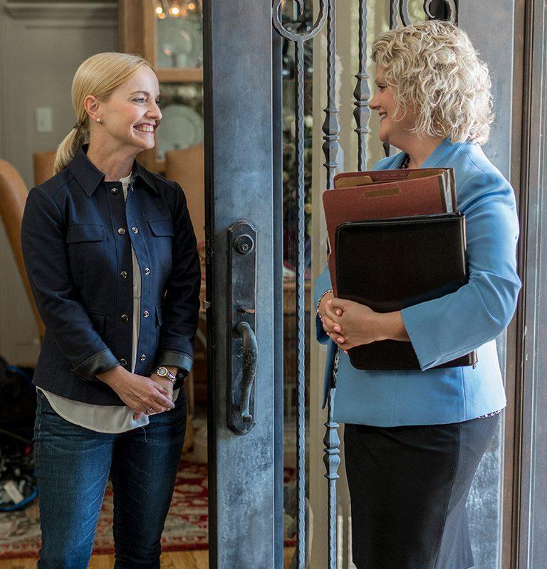 BB&T client Crissy Carlisle greets her advisor, Virginia Morris